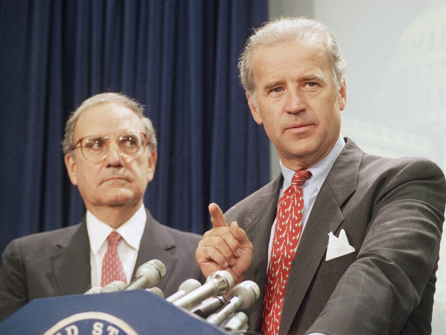 Then-Sen. Joe Biden (right) speaks at a Capitol Hill news conference in 1994 after the Senate voted on a major crime bill.