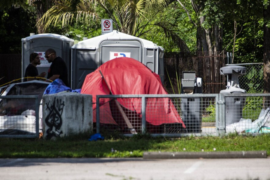 Portable bathrooms and hand washing stations installed near an encampment at the Terrazas Library just across I-35 in downtown.