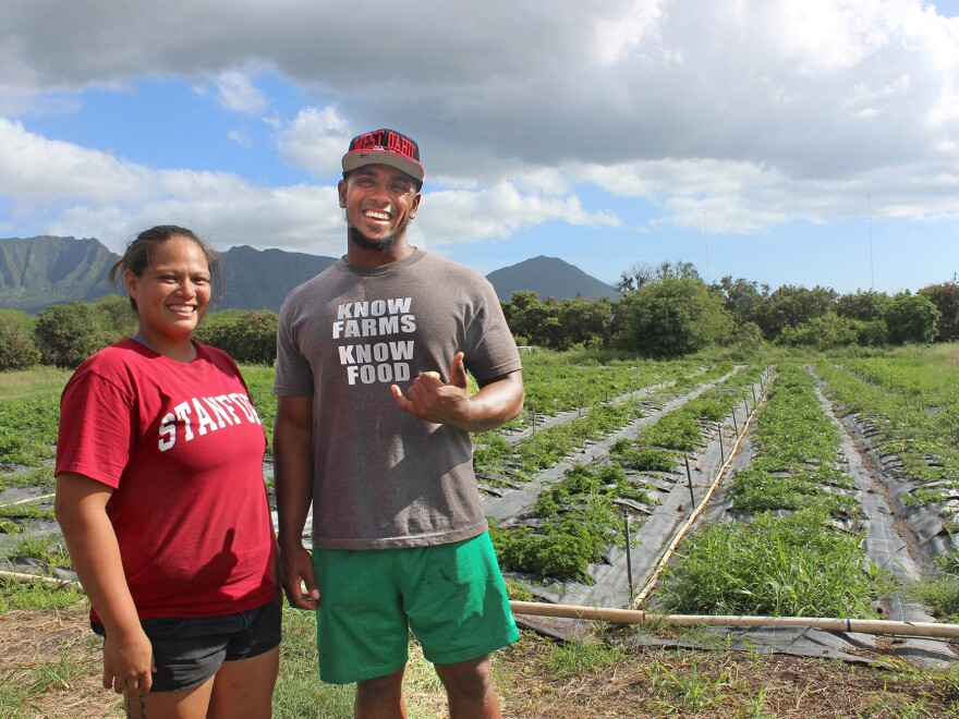 Cheryse Sana, left, and Derrik Parker were interns 10 years ago and now help manage the farm's current interns as well as run the day-to-day operations.