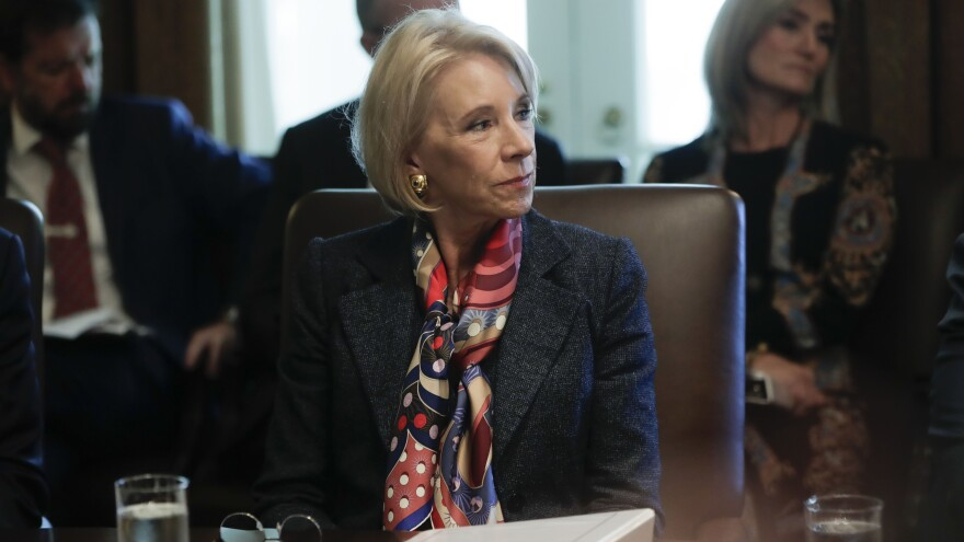 The judge said Education Secretary Betsy DeVos had violated an order to stop collecting loans owed by students who had been defrauded by Corinthian Colleges.