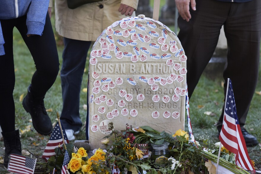 """The Mount Hope Cemetery in Rochester, N.Y., extended visiting hours on Election Day to accommodate those leaving """"I Voted"""" stickers and other mementos at the grave of Susan B. Anthony."""