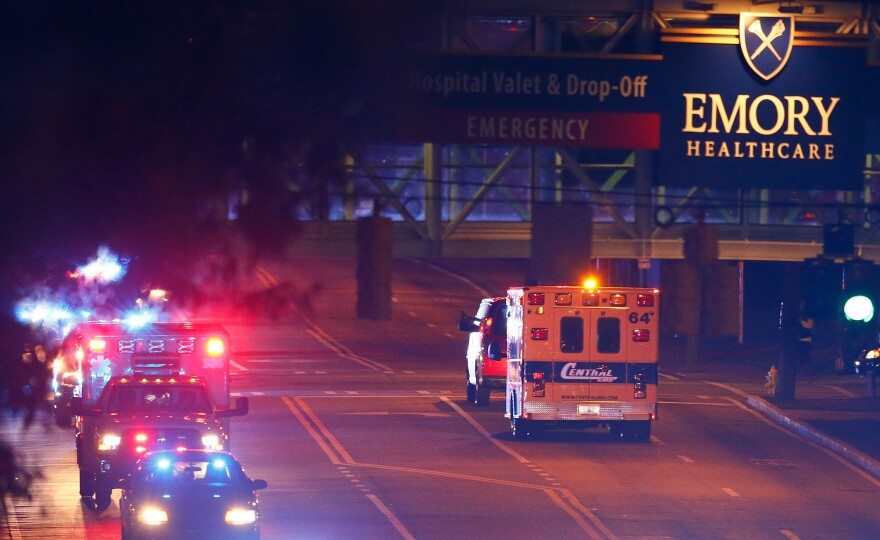 Ebola patient Amber Vinson arrived by ambulance at Emory University Hospital on Oct. 15. Now healthy, Vinson was discharged from the hospital Tuesday.