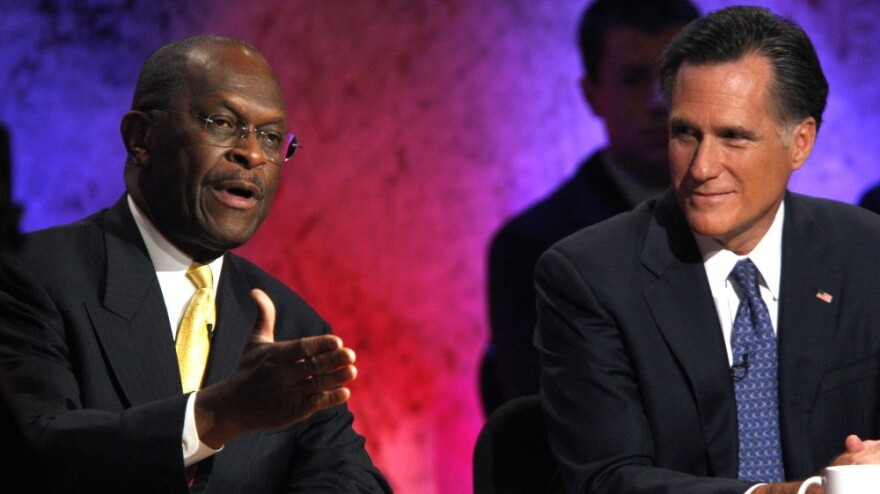 <p>Business executive Herman Cain, left, and former Massachusetts Gov. Mitt Romney during a debate Tuesday (Oct. 11, 2011) in New Hampshire. </p>