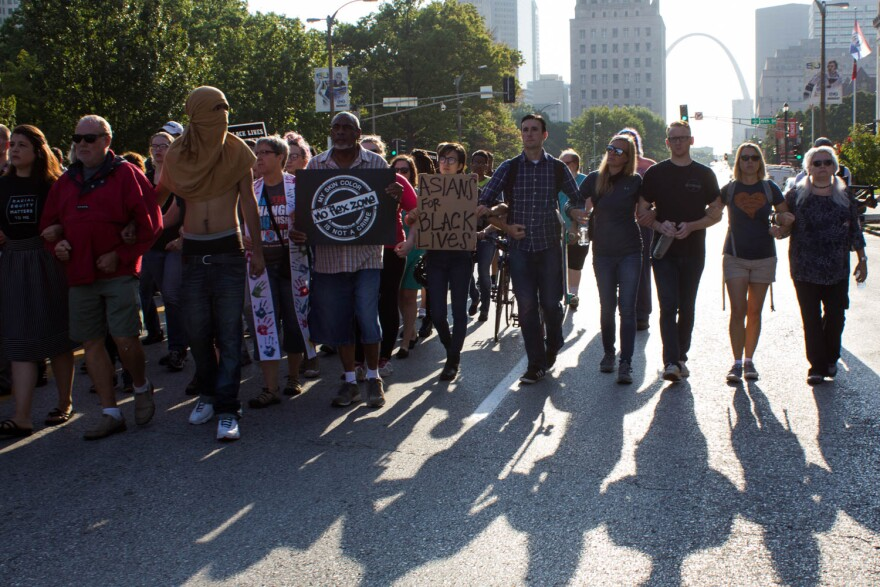 Protesters marched peacefully and largely in silence throughout downtown St. Louis early Monday morning. 9/18/17