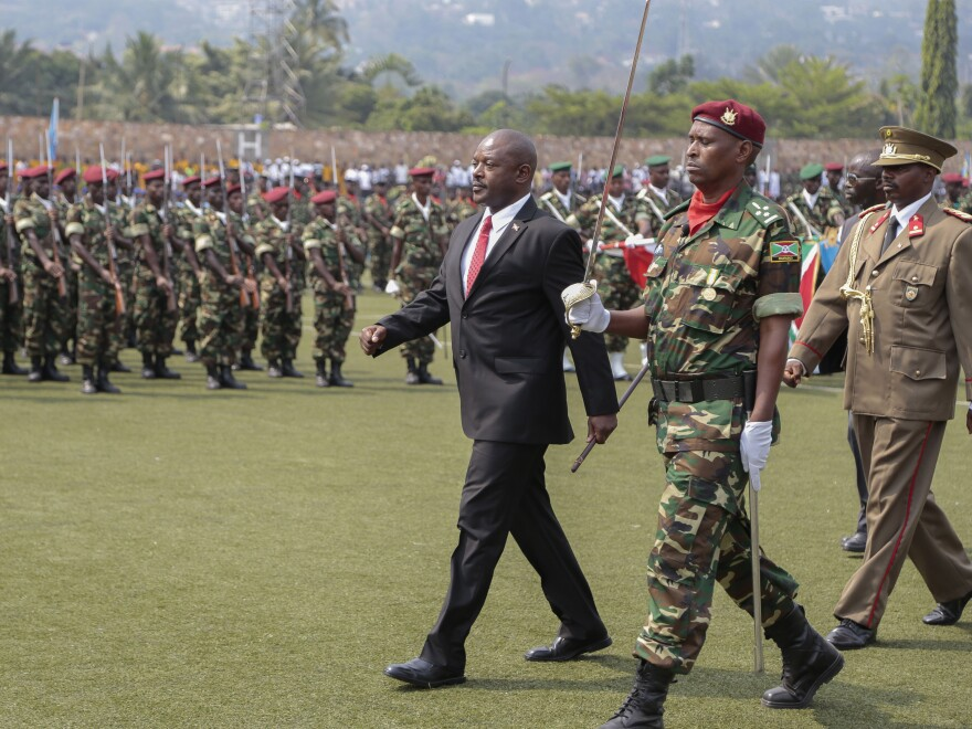 Burundi's President Pierre Nkurunziza walks with military officials during the country's Independence Day on Wednesday. Despite criticism at home and abroad, the president is defying a two-term limit and running for a third term in an election set for the middle of July.