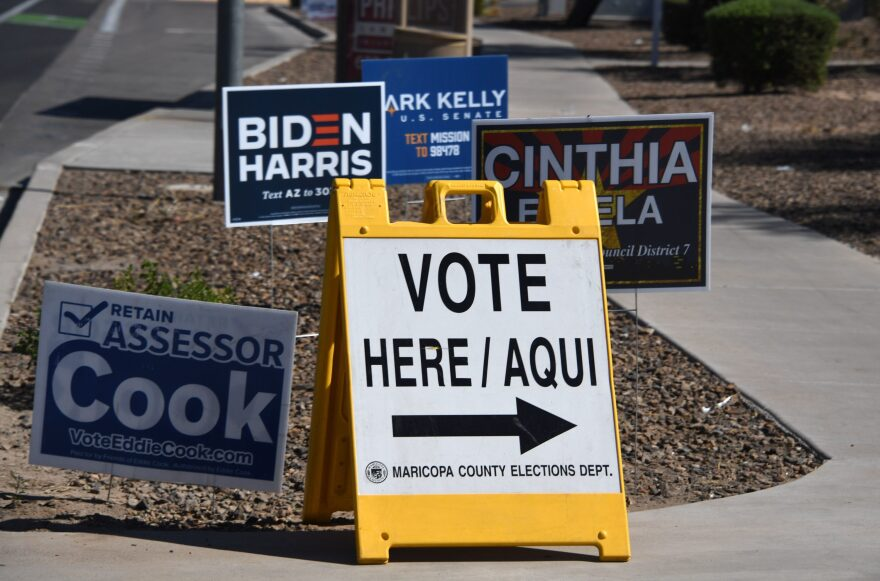 A sign points the way to an early voting location in Phoenix, Arizona on Oct. 16, 2020 ahead of the US presidential election. (Robyn Beck/AFP via Getty Images)