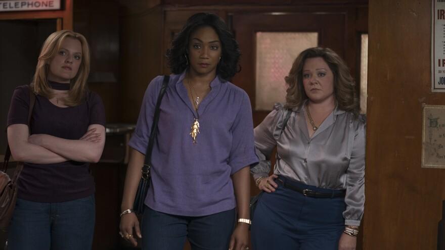 Hell(s Kitchen) hath no fury like a mob wife scorned: (L-R) Elisabeth Moss, Tiffany Haddish, and Melissa McCarthy star in New Line Cinema's drama <em>The Kitchen</em>.