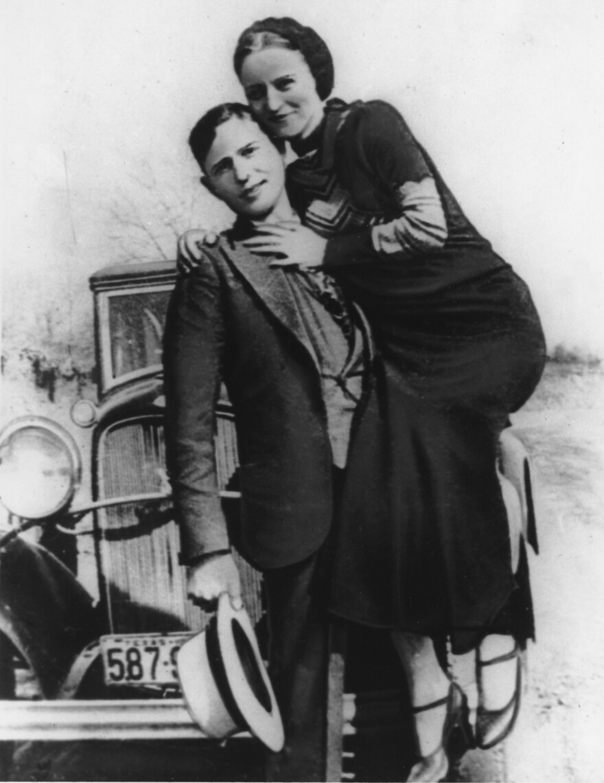 Clyde Barrow holds his partner-in-crime, Bonnie Parker.