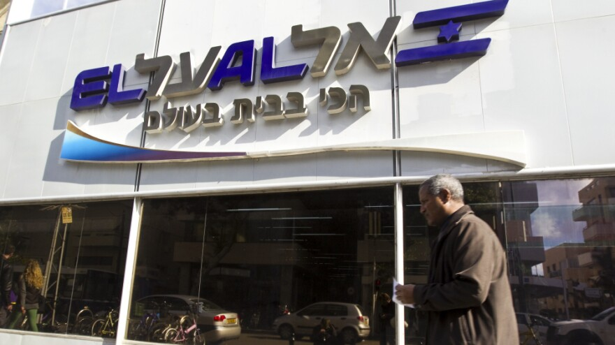 The websites of Israel's El Al airline and the Tel Aviv Stock Exchange were knocked offline Monday, just hours after a Saudi Arabian hacker threatened to act against them. Israeli hackers responded by crashing the Saudi stock exchange. Here, a man walks past an El Al office in Tel Aviv on Monday.