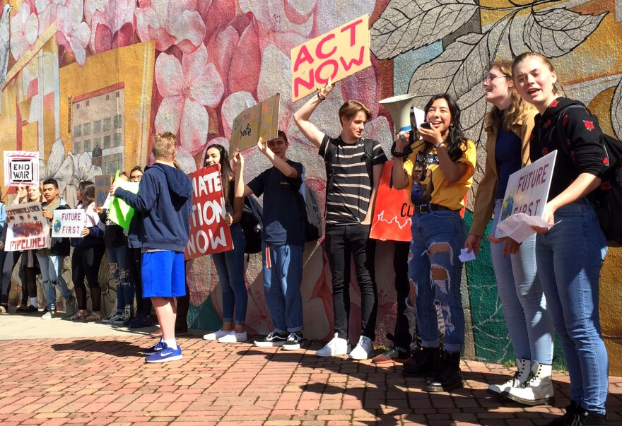 Image of students chanting with signs.