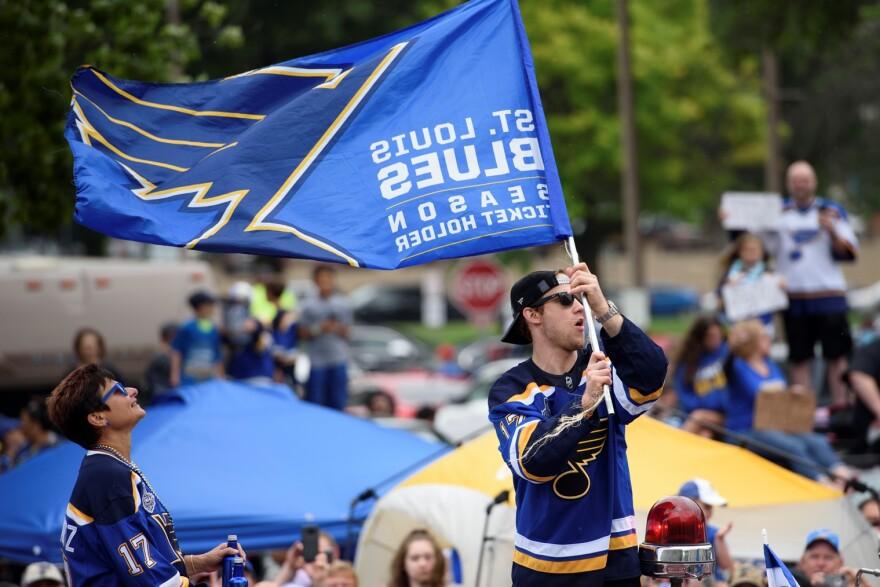 Blues forward Jaden Schwartz waves the Blues flag during the Blues championship parade. June 15, 2019