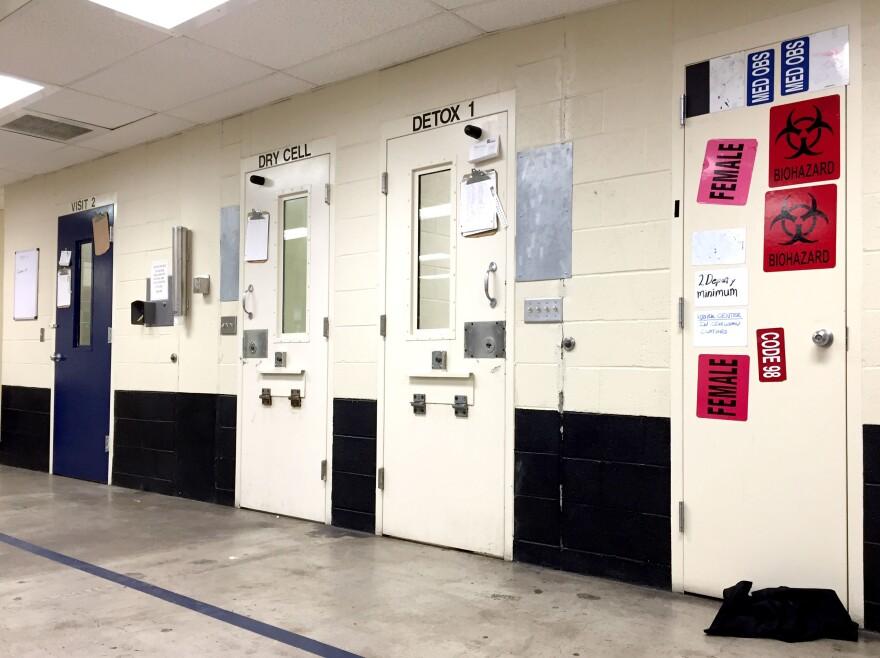 Image of metal doors of cells in a jail.