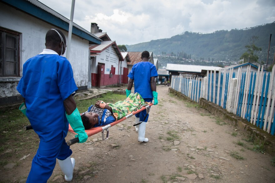 Medical workers transfer a patient from the Doctors Without Borders cholera treatment unit to the intensive care unit at the general hospital in Masisi, Democratic Republic of Congo.