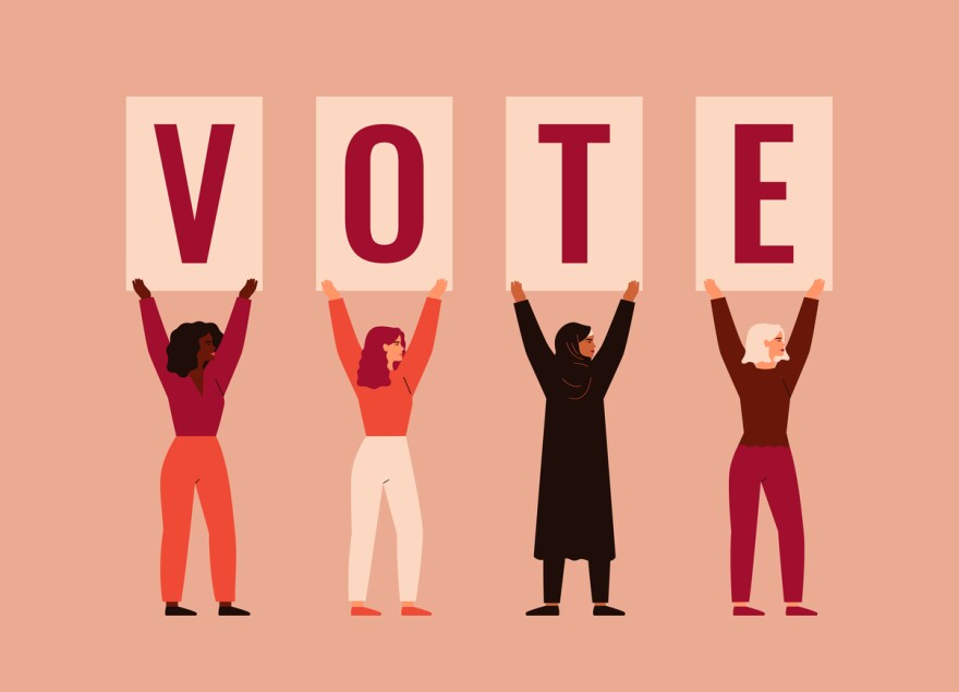 A graphic of women of different nationalities and cultures standing together and raising up posters with word VOTE.