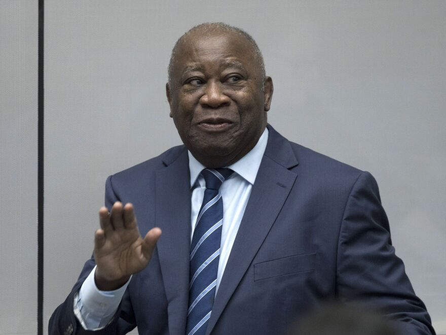 Former Ivory Coast President Laurent Gbagbo enters the courtroom of the International Criminal Court in The Hague, Netherlands, on Tuesday, where judges dropped the charges against him.