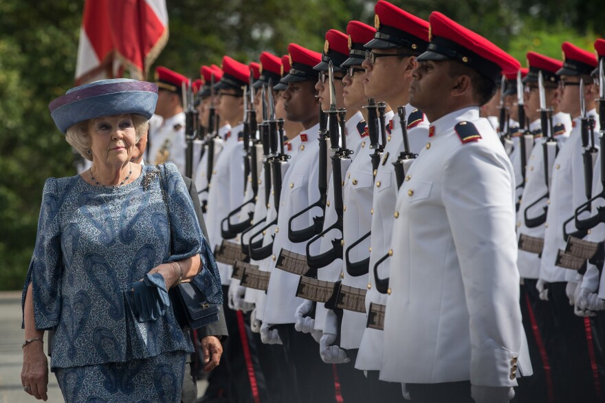 Queen Beatrix of the Netherlands inspects the honor guard with Singapore President Tony Tan at the Istana in January.