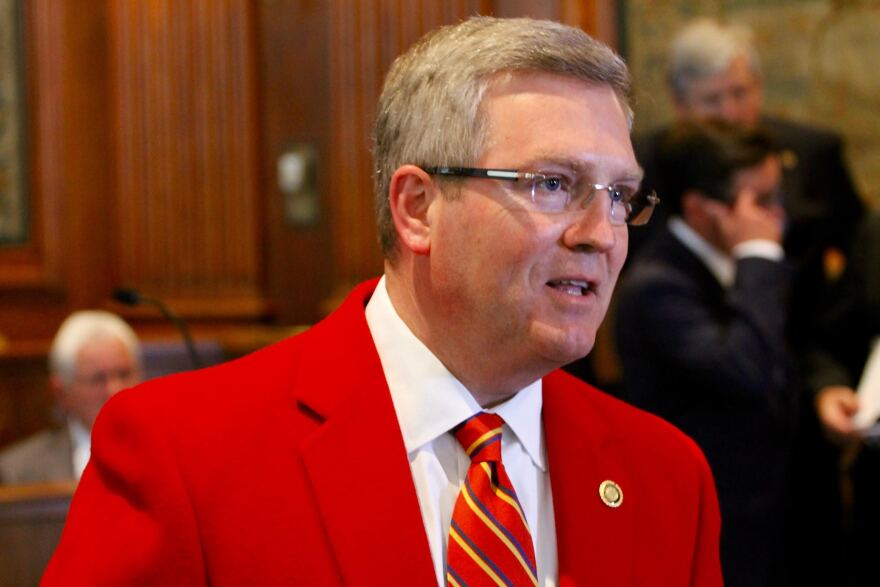 "Pearce is known for wearing a bright red sport coat on the Senate floor to honor Central Missouri State University. In 2009, then-Sens. Scott Rupp and Kevin Engler joked that he looked like Ron Burgundy for the film ""Anchorman."""