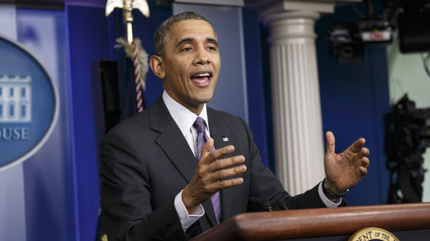 President Obama said eight million people signed up for health coverage through new insurance exchanges.