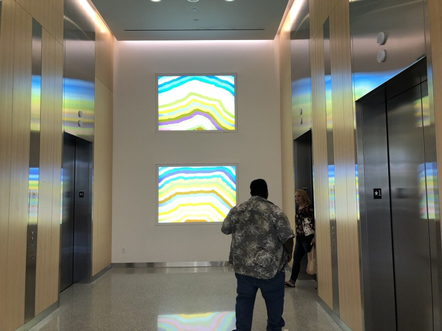 Two light boxes by famed artist Spencer Finch greet guests by the elevators of the Taussig Cancer Center.