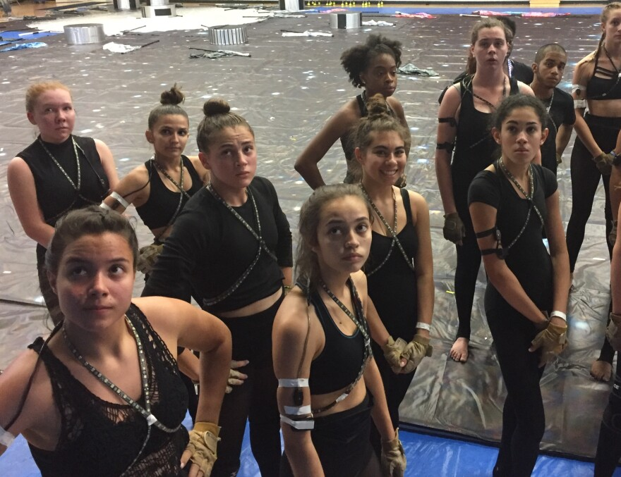 The Flanagen high school color guard regroups after practicing  their space-age themed entry in in the 2017 finals. The team includes Captain Natalie Santana (far left, front) and Adyn Register (third from left, back).