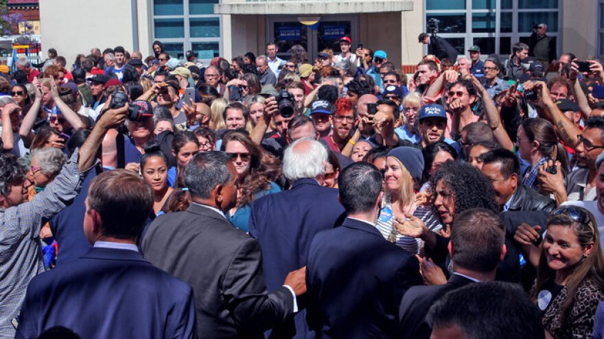 Sen. Bernie Sanders (center) reaches out to supporters after speaking at a get-out-the-vote canvass launch at the City College of San Francisco ahead of the 2016 California primary.