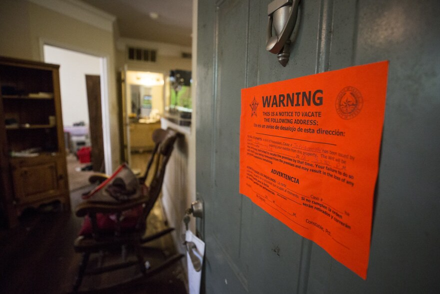 An eviction notice is posted on a home in Southwest Austin in 2018.
