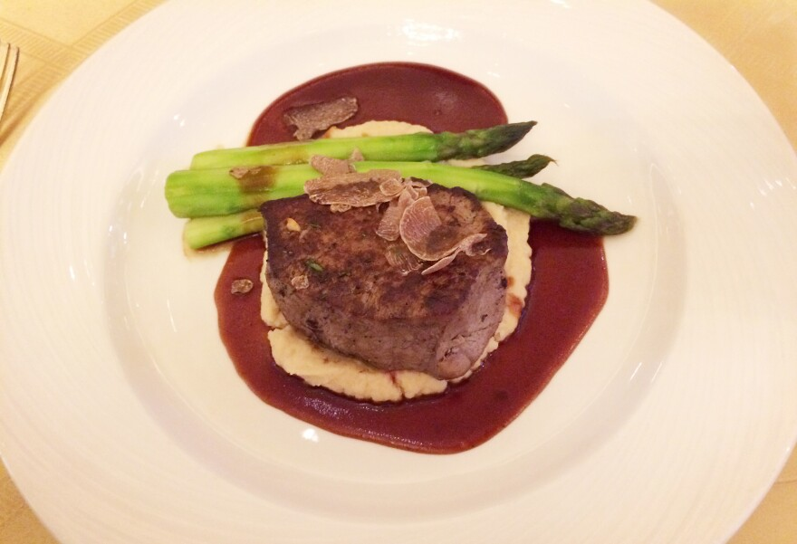 Filet mignon with asparagus, celery root purée, red wine sauce and shaved truffles.