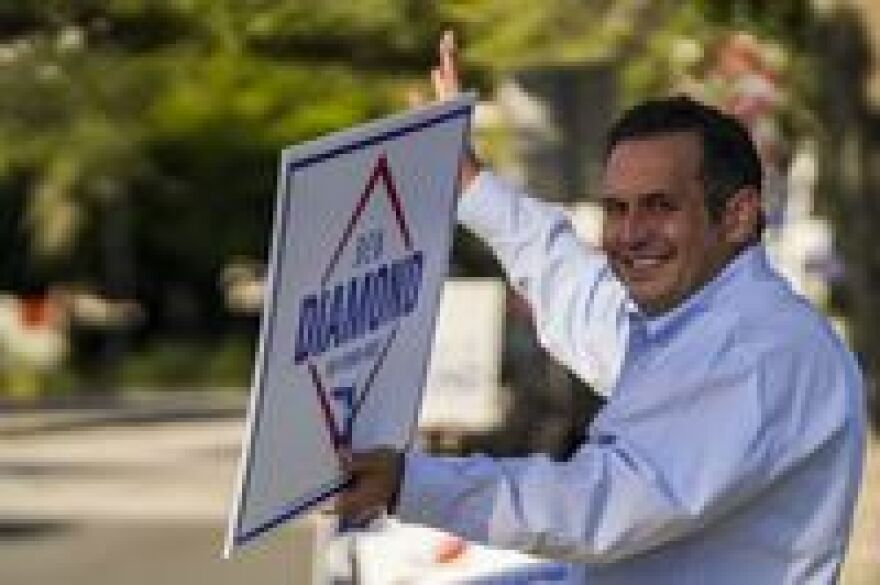 Ben Diamond holding a campaign sign