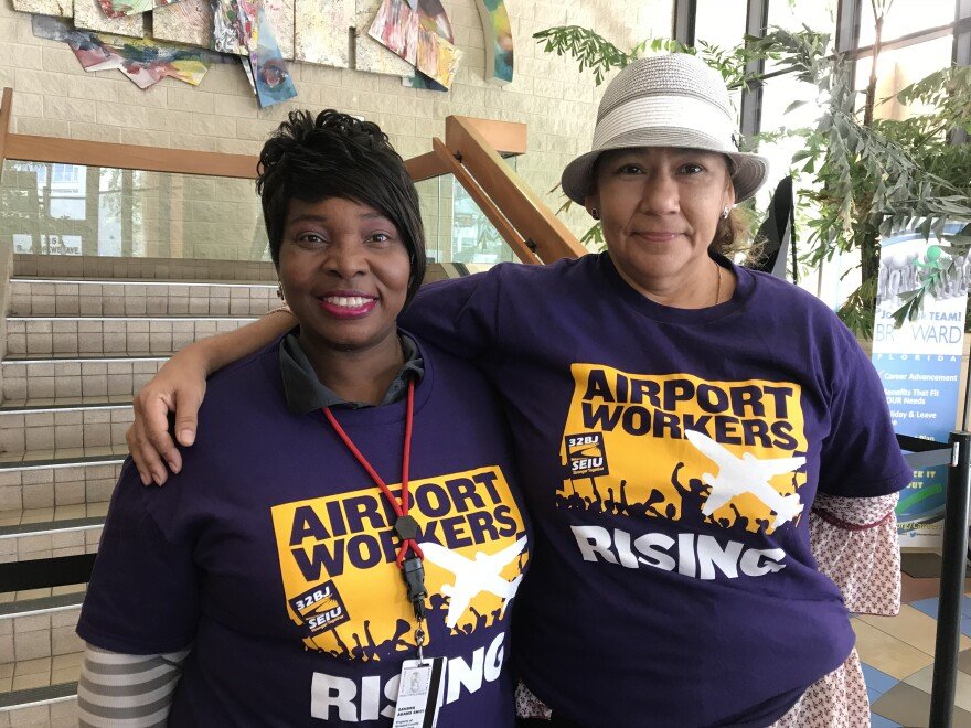 two women wearing airport workers rise t shirts