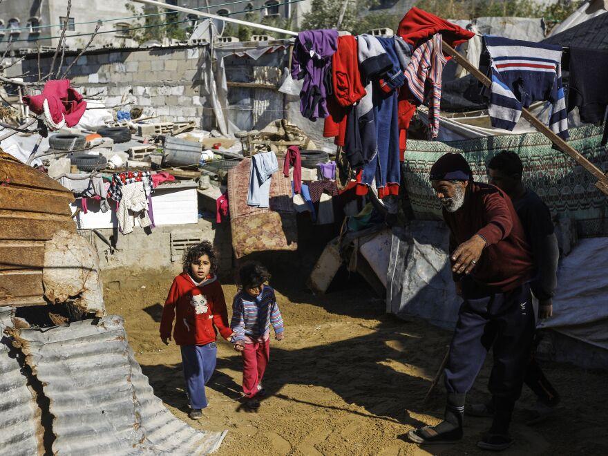 Two Palestinian girls walk in the Jabalia refugee camp in the northern Gaza Strip in 2017.