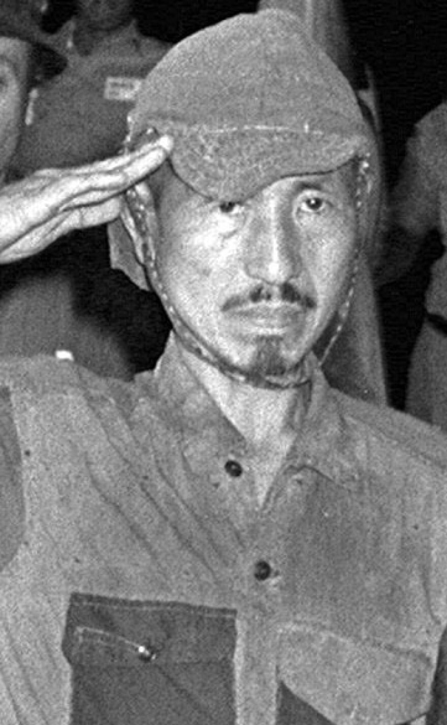 Hiroo Onoda, who wouldn't surrender for nearly three decades and continued to battle with villagers in the Philippines, in March 1974 after he was convinced to give up.