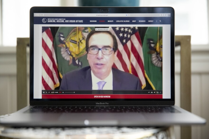 Treasury Secretary Steven Mnuchin speaks during a virtual hearing of the Senate Banking Committee on Tuesday. Mnuchin and Federal Reserve Chair Jerome Powell spoke about the rescue package passed by the Congress in March.