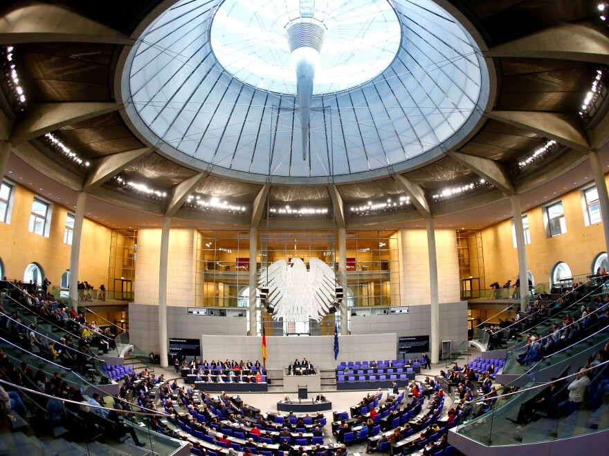 Hacked information that was leaked via Twitter included private data from German Chancellor Angela Merkel — seen here speaking in Germany's Bundestag last month.