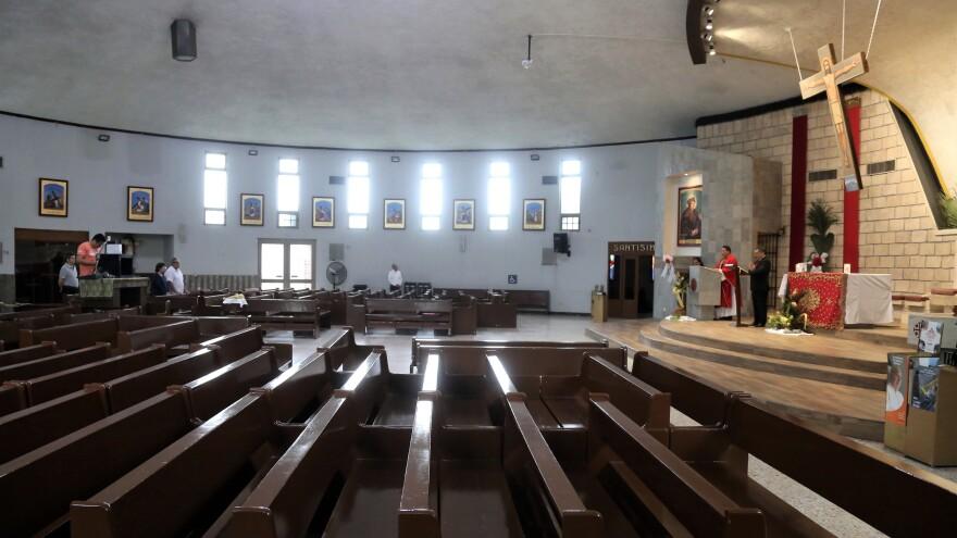 Felipe Samaniego officiates at a Roman Catholic Mass, streamed via Facebook from the Santo Tomás Moro church on Palm Sunday, in Monterrey, Mexico.