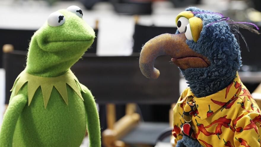 Kermit the Frog speaks to Gonzo the Great in a scene from ABC's <em>The Muppets</em>.
