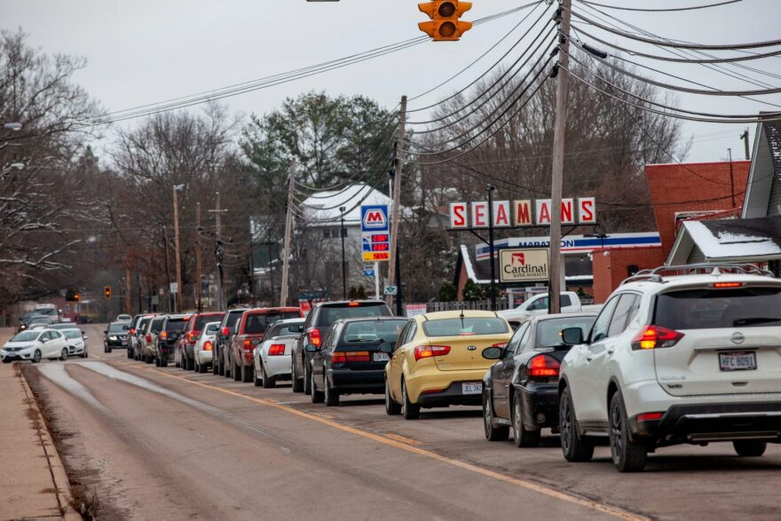 Cars line up to enter the Athens County Fairground from West Union Street to get food boxes from the Food Soldier Hunger Coalition through the USDA Farmers to Families Food Box Program in Athens, Ohio.