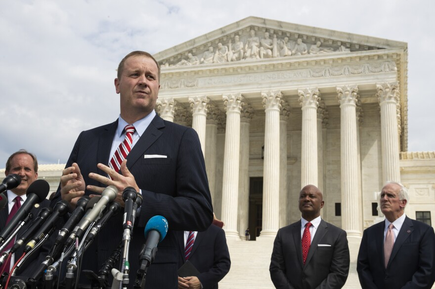 Missouri Attorney General Eric Schmitt speaking in front of the U.S. Supreme Court in Washington, D.C. in September 2019.