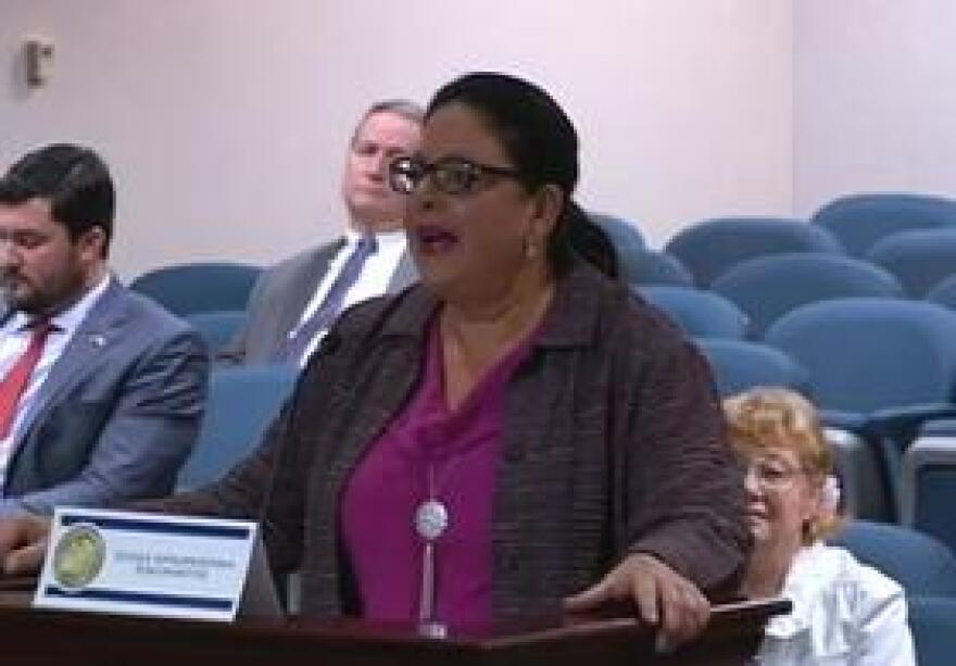 Violet Gonzalez speaking before a House committee last month. She's with MACtown. The agency's caregiver Charles Kinsey was shot by a police officer while his hands were raised and he was lying on the ground. His autistic patient, Arnaldo Rios, had a toy truck in his hand, though officers say they believed it was a gun.