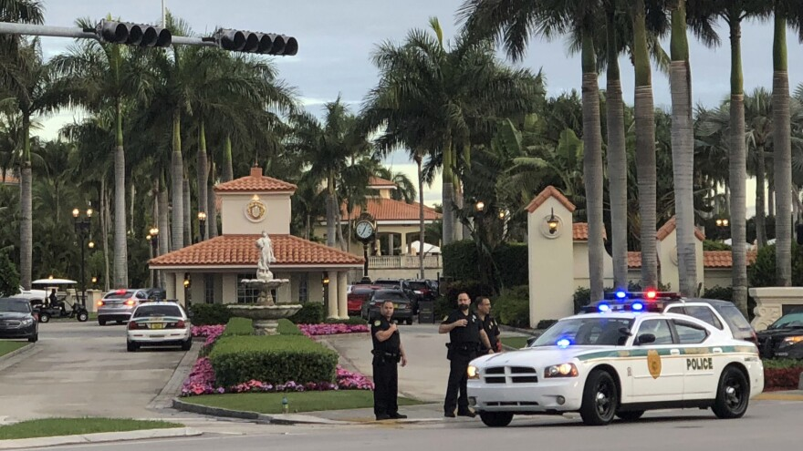 Police respond to The Trump National Doral resort after reports of a shooting inside on Friday.