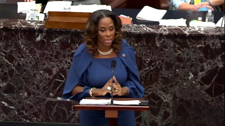 Del. Stacey Plaskett of the U.S. Virgin Islands, a House impeachment manager, played senators new video and audio footage documenting the violent mayhem of the insurrection at the U.S. Capitol on Jan. 6.