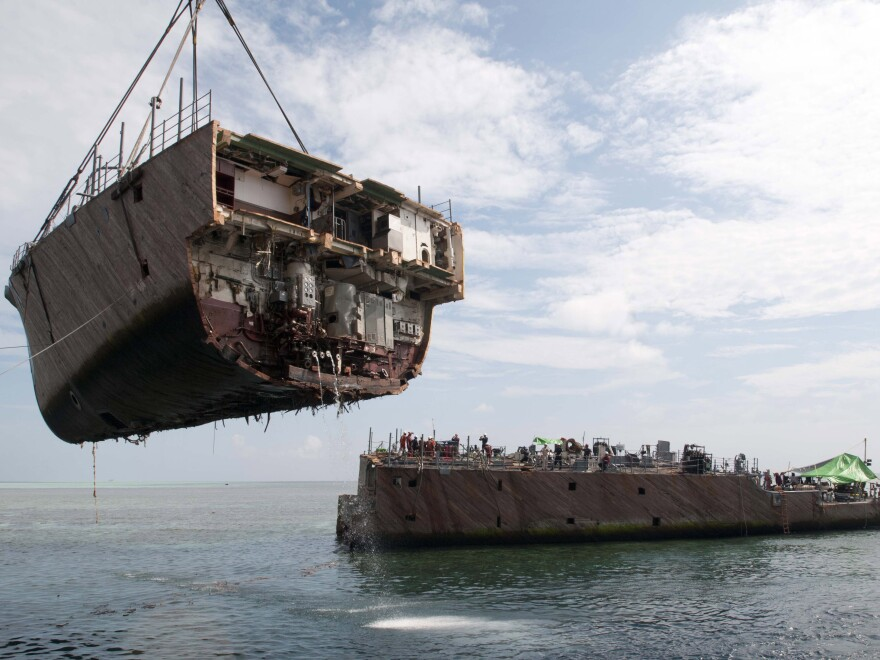 The bow of the mine countermeasure ship Guardian is removed in March in the Sulu Sea, Philippines. The Guardian ran aground on the Tubbataha Reef in January.
