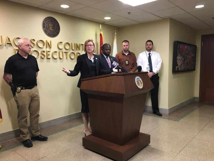 Jackson County Prosecutor Jean Peters Baker, center, in an April photo announcing murder charges in a case that crossed the state line.