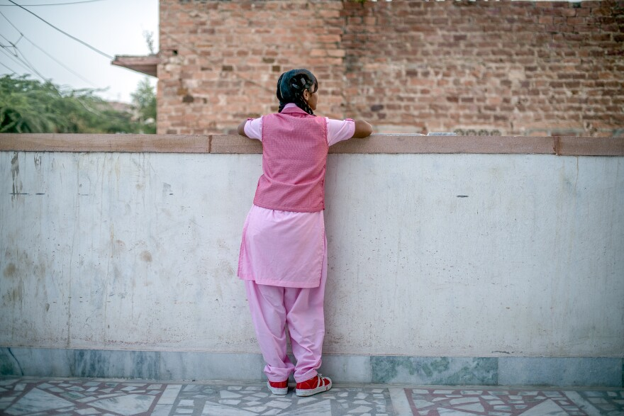"Nimmu, 15, on the terrace of the Veerni Institute. To stay in school, she needs to pass a national test this March. The problem: ""I'm not a great student,"" she says. Because child marriage is illegal in India, we can't use her full name."