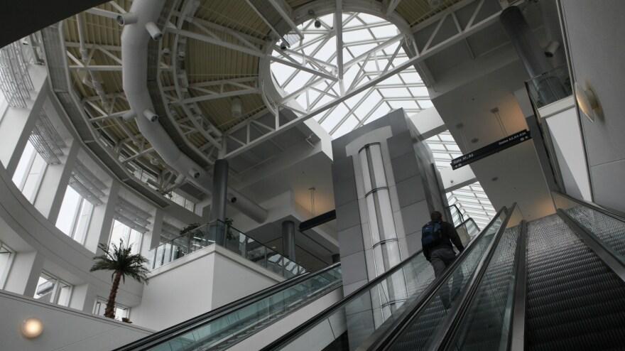 A passenger rides an escalator to Terminal A at the Cincinnati/Northern Kentucky International Airport in Erlanger, Ky.