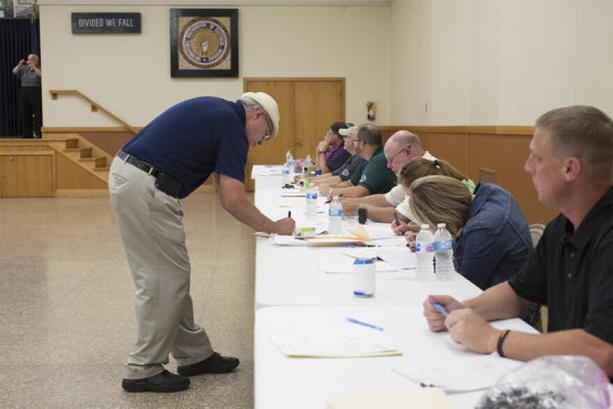 Union leaders set up tables and booths at the International Brotherhood of Electrical Workers Hall on Aug. 8, 2017 to collect notarized petitions to force a statewide vote over Missouri's right-to-work law.