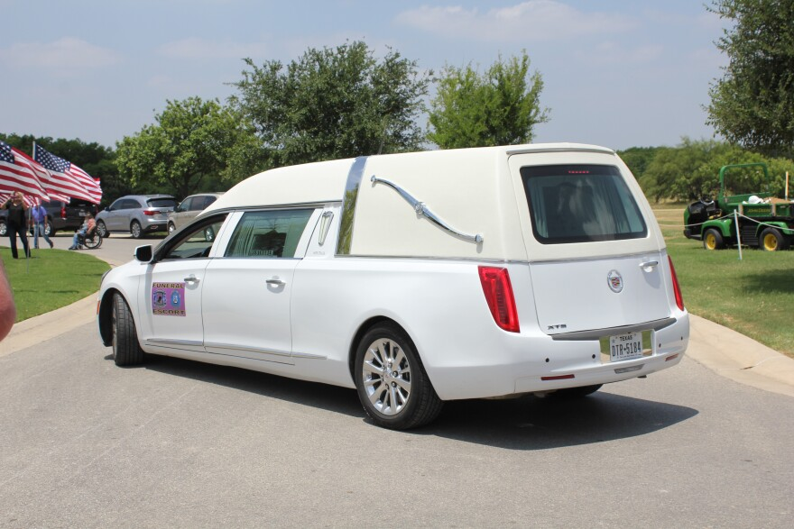 The hearse and processional made their way to a processional, where a memorial service was planned.