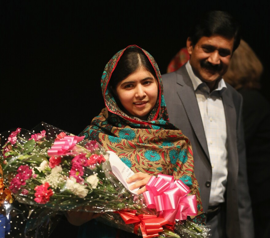 After learning that she'd won the Nobel Peace Prize, Malala Yousafzai celebrated with her father, Ziauddin Yousafzai, in Birmingham.