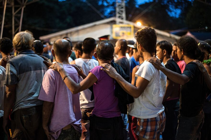 Alleged drug dealers and addicts surrender to authorities to undergo drug tests at Camp Karingal in Manila in June. Many Filipinos involved with drugs have died since President Rodrigo Duterte won a landslide election in May, promising to rid society of drugs and crime in six months by killing tens of thousands of criminals.