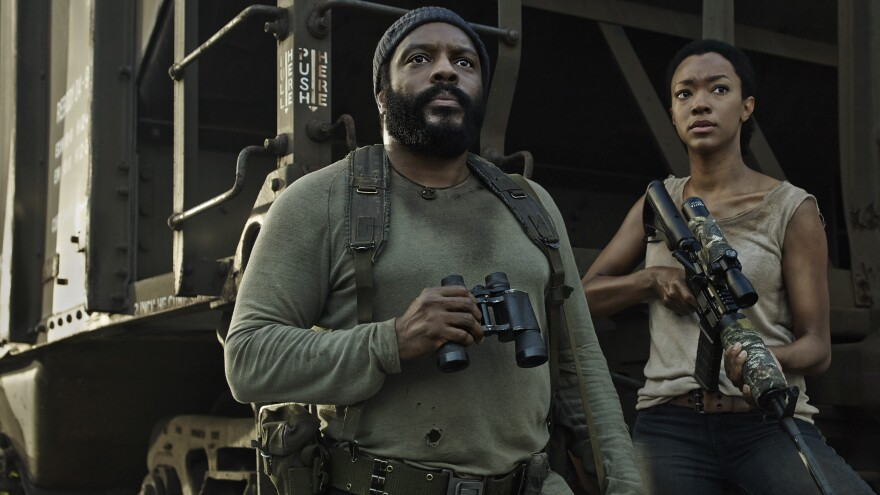 Chad Coleman, left and Sonequa Martin-Green star as Tyreese and Sasha on AMC's <em>The Walking Dead.</em>