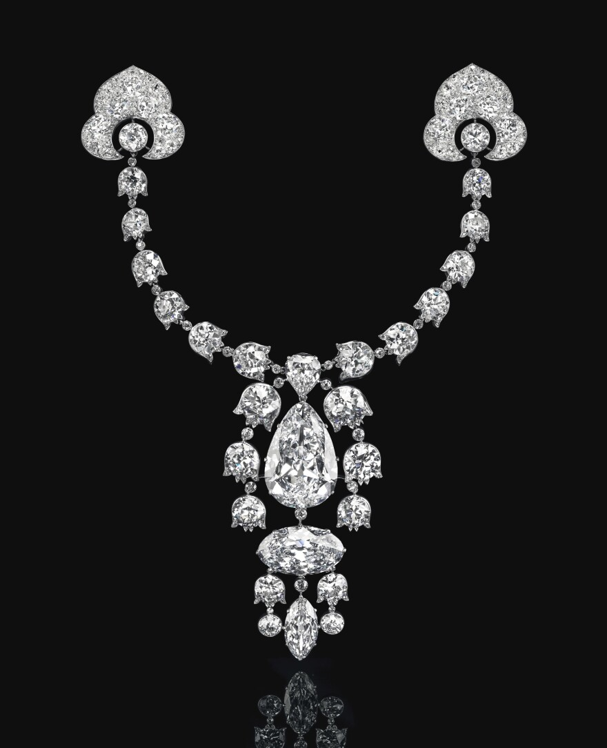 This brooch features five different cuts of diamonds, including a pear brilliant-cut stone of 34.08 carats and an oval brilliant-cut diamond of 23.55 carats.